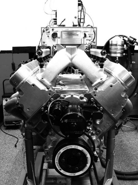 By raising the carburetor or throttle body, air can travel in a direct path into the intake ports. Air doesn't like to bend or change directions, so this arrangement yields dividends in airflow and powe