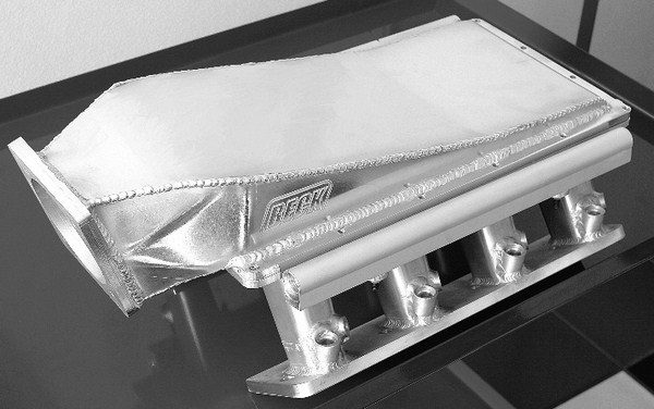 If readily available factory or aftermarket intake manifolds are deemed unsuitable for an application, there's always the option of stepping up to a custom sheetmetal intake. Each one is custom fabricated for a specific application, so although a custom intake is extremely expensive at $1,500 to $2,000, it's capable of performing extremely well.